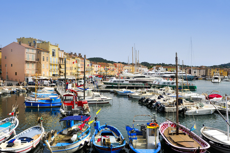 sailboats: Saint-Tropez, France - May 13, 2015: A view of the Old Port in Saint-Tropez, France. Saint-Tropez is a famous destination for European and Worldwide tourists in the French Riviera Editorial