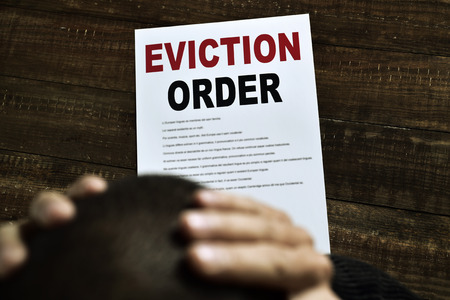 recourse: a young caucasian man with his hands in his head concerned because has just received an eviction order