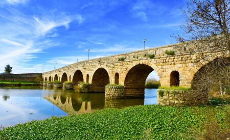 merida: a view of the Puente Romano, an ancient Roman bridge over the Guadiana River, in Merida, Spain