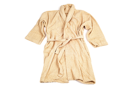 towelling: a terrycloth bathrobe in salmon color on a white background