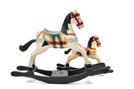 yesteryear: a pair of old wooden rocking horses on a white background Stock Photo