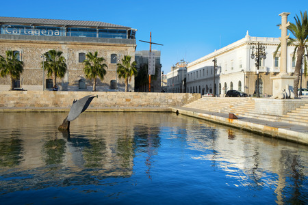 seawater: Cartagena, Spain - December 26, 2015: A view of the port of Cartagena, Spain, and the Whale Tail sculpture, designed by Fernando Saenz de Elorrieta, emerging of the seawater