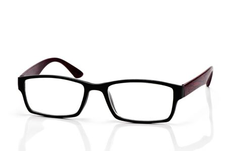 eyestrain: closeup of a pair of plastic and wooden rimmed eyeglasses on a white background