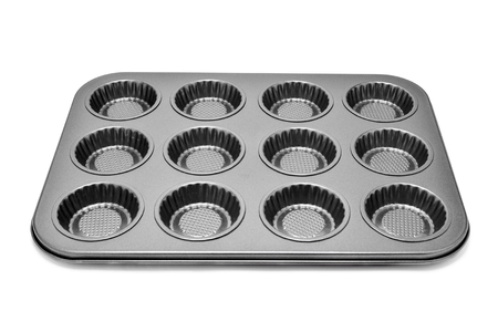 baking tray: a non stick baking tray with different holes for muffins or cupcakes on a white background