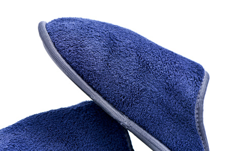 houseshoe: closeup of a pair of warm slippers on a white background