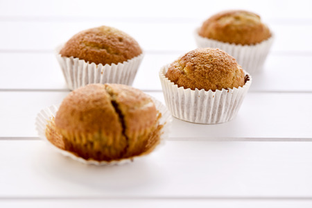 madalena: some magdalenas, typical spanish plain muffins, on a white surface