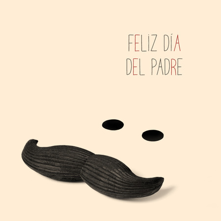 happy fathers day in spanish, and a mustache and two black dots forming a funny man face on a beige background
