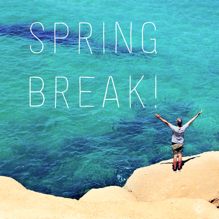 spring break: a young man seen from behind with his arms in the air in front of the ocean and the text spring break