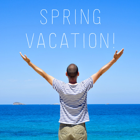 vac: a young man seen from behind with his arms in the air in front of the ocean and the text spring vacation