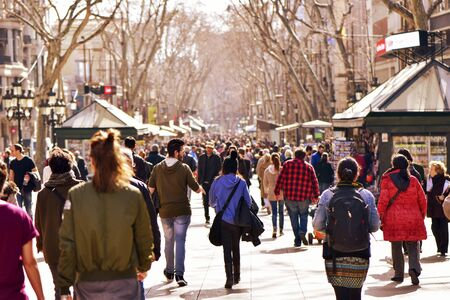 rambla: Barcelona, Spain - February 21, 2016: People walking in La Rambla in Barcelona, Spain. Thousands of people walk daily by this popular pedestrian mall 1.2 kilometer-long