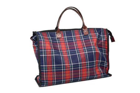 consumerist: a plaid shopping bag on a white background
