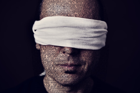 repress: closeup of a young man patterned with no-sense words with a blindfold in his eyes, depicting the idea of lack of press freedom