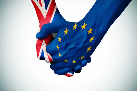 european community: two persons holding hands patterned with the flag of the United Kingdom and the flag of the European Community, with a vignette added