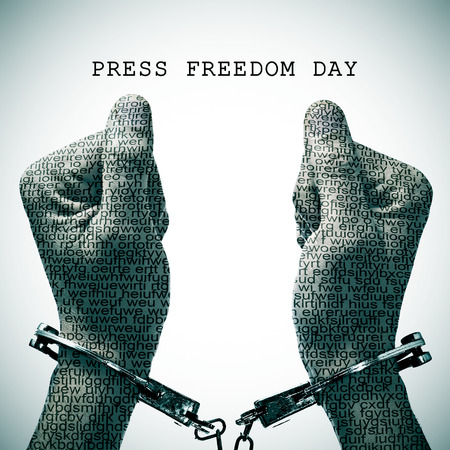 repress: the text press freedom day and a handcuffed man with his hands and wrists patterned with no-sense words Stock Photo
