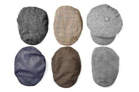유행: 흰색 배경에 다른 모자의 높은 앵글 샷 스톡 콘텐츠