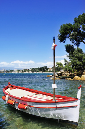 quite: a fishing boat moored in a quite cave in the Mediterranean sea, in the French Riviera, France Stock Photo