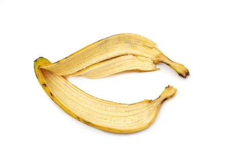 leftover: closeup of the skin of a banana on a white background