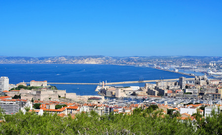 old port: aerial view of Marseille, France, with the Fort Saint-Nicolas and the Old Port in the foreground