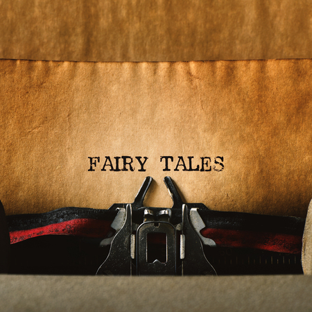 folk tales: closeup of an old typewriter and the text fairy tales written with it in a yellowish foil