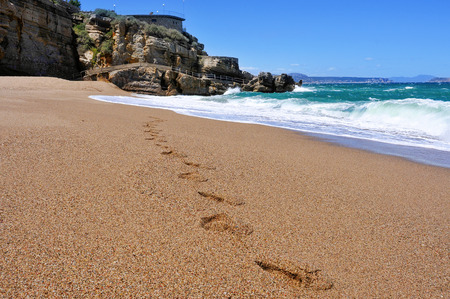 nudism: footprints in the sand of the Cala Illa Roja beach in Begur, in the Costa Brava, Catalonia, Spain