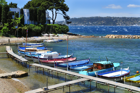 french riviera: view of some fishing boats moored in a small cove in the Mediterranean sea, in the French Riviera, France