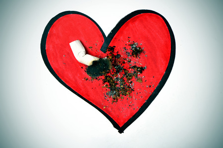 anti tobacco: a cigarette butt put out on a drawing of a red heart, with a dramatic effect