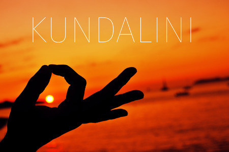 kundalini: closeup of a young man meditating with his hands in gyan mudra at sunset and the text kundalini