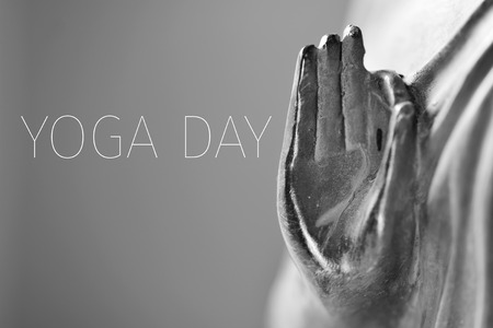 gyan: detail of a representation of the Buddha with his hand in gyan mudra in duotone and the text yoga day