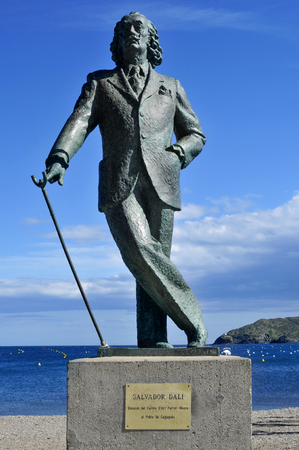 salvador dali: Cadaques, Spain- May 20, 2015: Detail of a bronze life-size statue to famous Salvador Dali in Cadaques, Spain. This small town in the Costa Brava holds the House-Museum of the artist