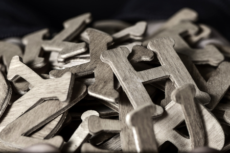 duotone: closeup of a pile of different wooden letters, in duotone