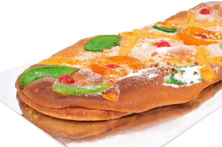 juan: closeup of a coca de Sant Joan, a typical sweet flat cake from Catalonia, Spain, eaten on Saint Johns Eve, on a white background
