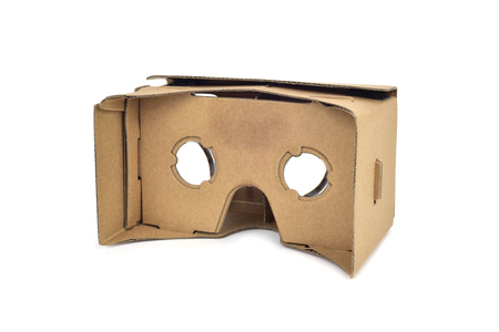 viewer: closeup of a pair cardboard virtual reality lenses on a white background