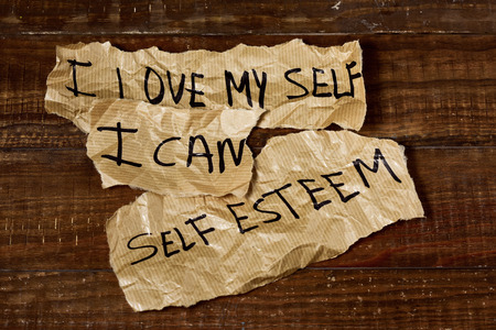 narcissist: the text I love myself, I can and self esteem written in some pieces of paper, placed on a rustic wooden surface