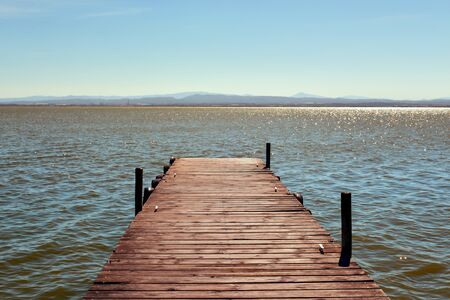 wooden dock: a wooden dock over the lagoon in the Albufera de Valencia, in Valencia, Spain