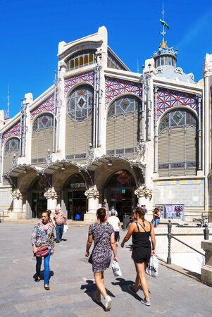 mercado central: Valencia, Spain - June 21, 2016: A view of the Mercado Central in Valencia, Spain. This building built in modern art nouveau style is the seat of the main public market in the city