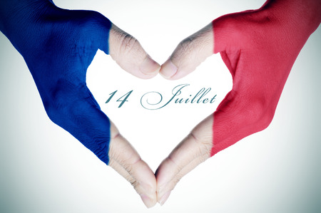 14th: woman hands forming a heart patterned with the flag of France and the text 14 juillet, 14th of July, the National Day of France, written in French
