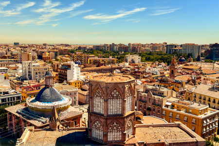 old quarter: an aerial view of the roof of the Cathedral and the old town of Valencia, Spain, as seen from the Micalet, the belfry, highlighting the blue tiled dome of the Basilica de la Virgen de los Desamparados