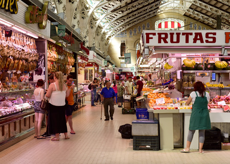 public market: Valencia, Spain - June 21, 2016: Interior view of the Mercado Central in Valencia, Spain. This building built in modern art nouveau style is the seat of the main public market in the city