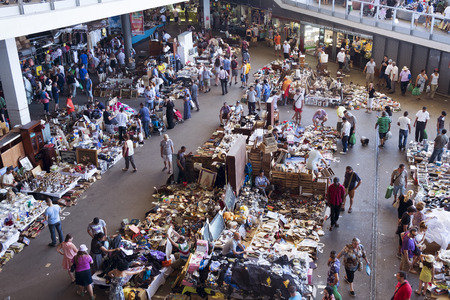 half stuff: Barcelona, Spain - July 9, 2016: People at Els Encants flea market in Barcelona, Spain. This popular flea market in the city is full of an assortment of used bits and pieces on sale Editorial