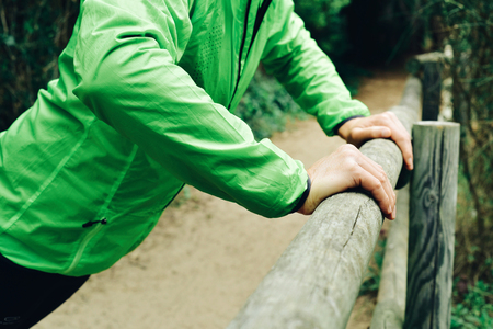 to incline: closeup of a young caucasian sportsman wearing sport clothes doing incline push-ups outdoors Stock Photo