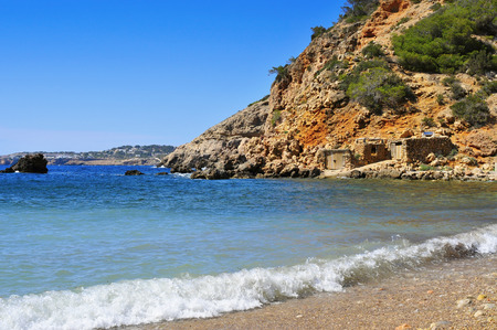 a view of a lonely cove in Ibiza Island, Spain, with some traditional fishermen shelters Reklamní fotografie