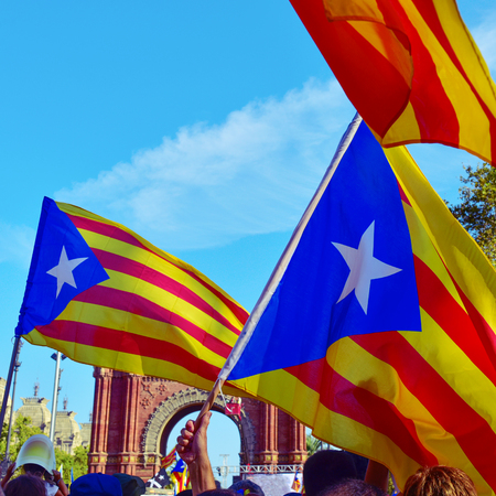 separatist: unrecognizable people partaking in a rally in support for the independence of Catalonia in Barcelona, Spain, during the National Day of Catalonia