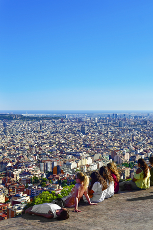 Barcelona, Spain - August 15, 2016: People observing the city from above in Barcelona, Spain. From the top of the hill, there is a wonderful view of the city Editorial