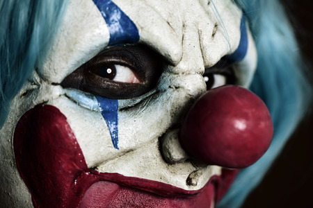 Evil clown: closeup of a scary evil clown Stock Photo