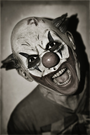 sepia toning: portrait of a scary evil clown, in sepia toning, with a retro effect Stock Photo
