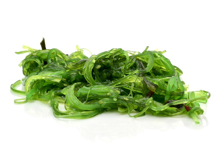 goma wakame or seaweed salad on a white background