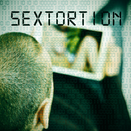 closeup of a young caucasian man watching a woman in his tablet computer and the word sextortion in the foreground Stock Photo