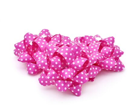 loopy: some gift puff bows made with pink ribbon patterned with white dots, on a white background Stock Photo