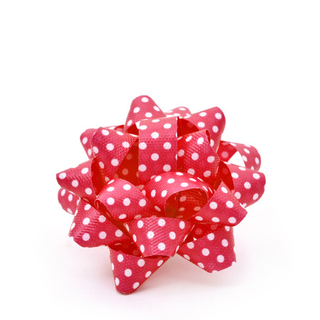 loopy: a gift puff bow made with red ribbon patterned with white dots, on a white background