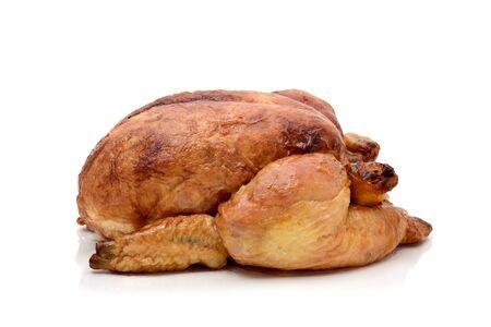 pollo rostizado: un pavo asado o un pollo asado sobre un fondo blanco
